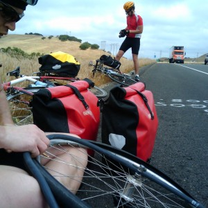 A man fixing a flat tyre on his bicycle