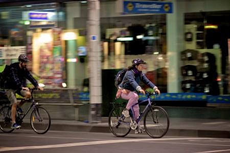 A couple ride bikes in Melbourne